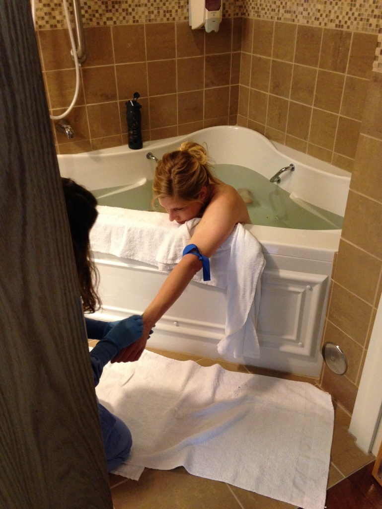 Getting an IV port while laboring in the tub.